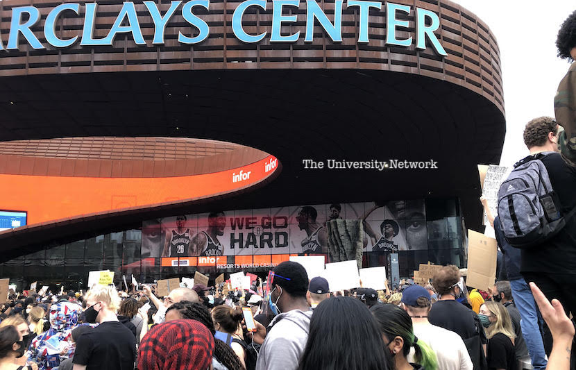 Hundreds of Brooklyn protesters gather outside of Barclays Center on Friday.